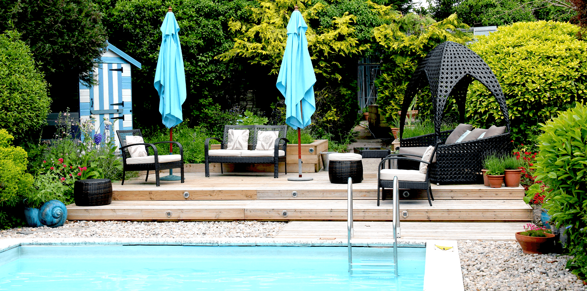 Chilled poolside sundeck by the pool at Springwells in Steyning