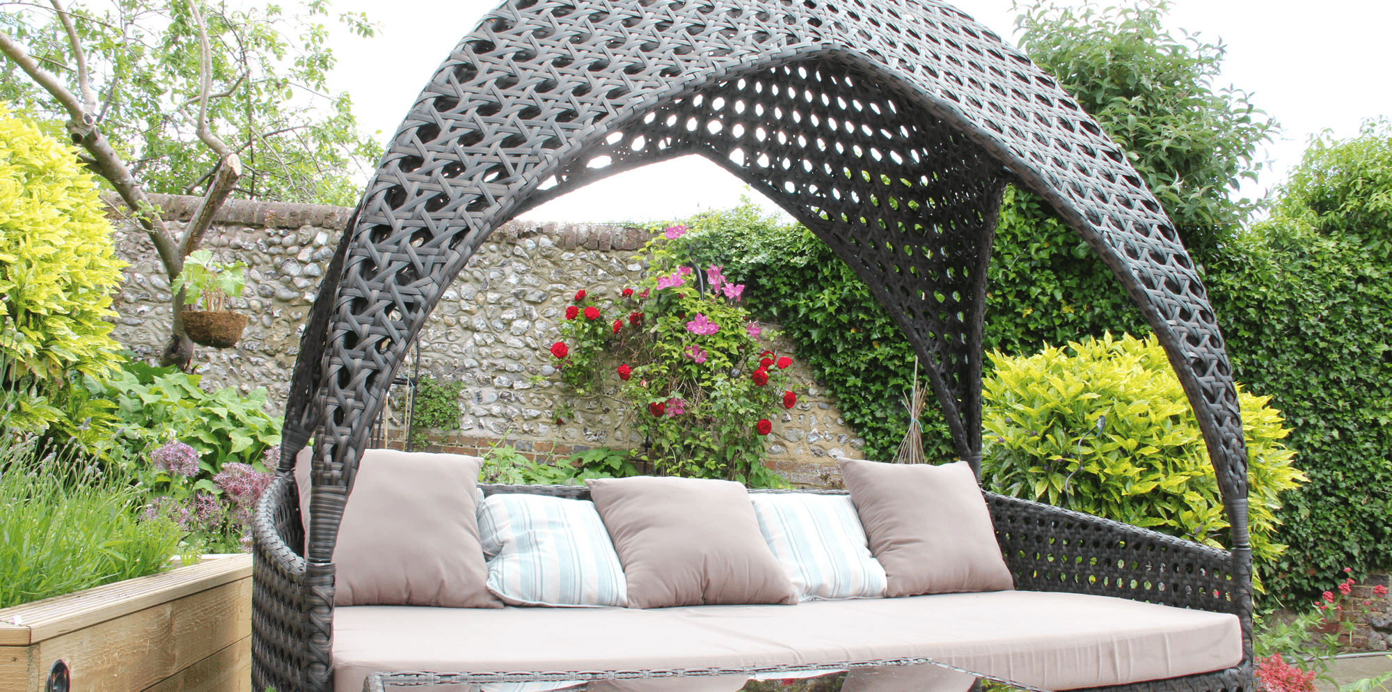Large relaxing seating by the pool at Springwells in Steyning